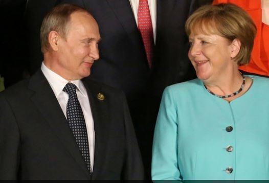 Путин и Меркель обсудили критическое положение на Украине »