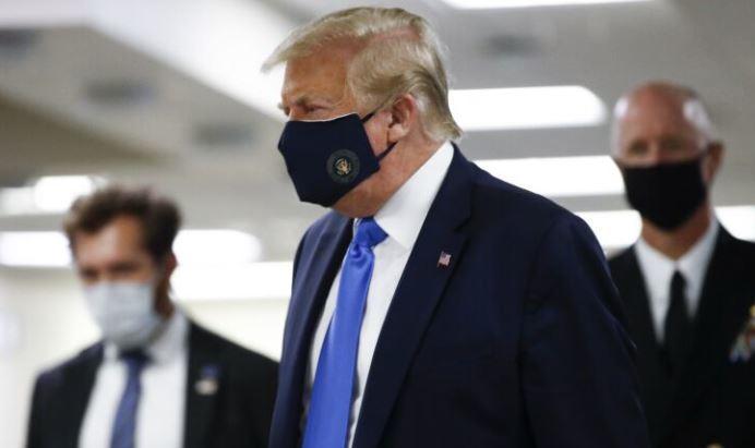Трамп впервые за время пандемии появился на публике в маске 1